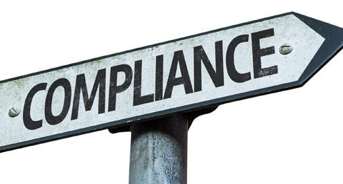 A sign points to the compliance audit road.