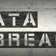 Data breach is stenciled on the wall.